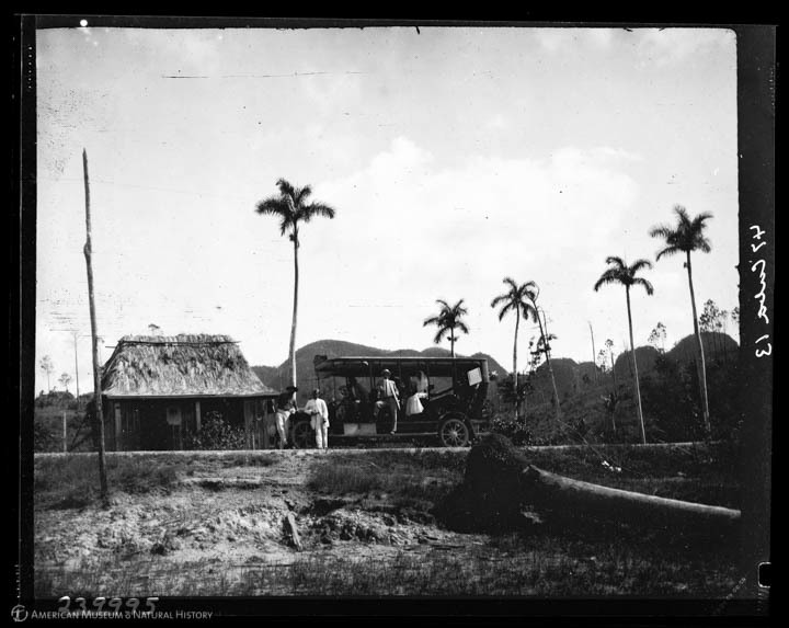 The stage [coach] from Pinar del Rio with a bride climbing aboard in Vinales, Cuba, 1913