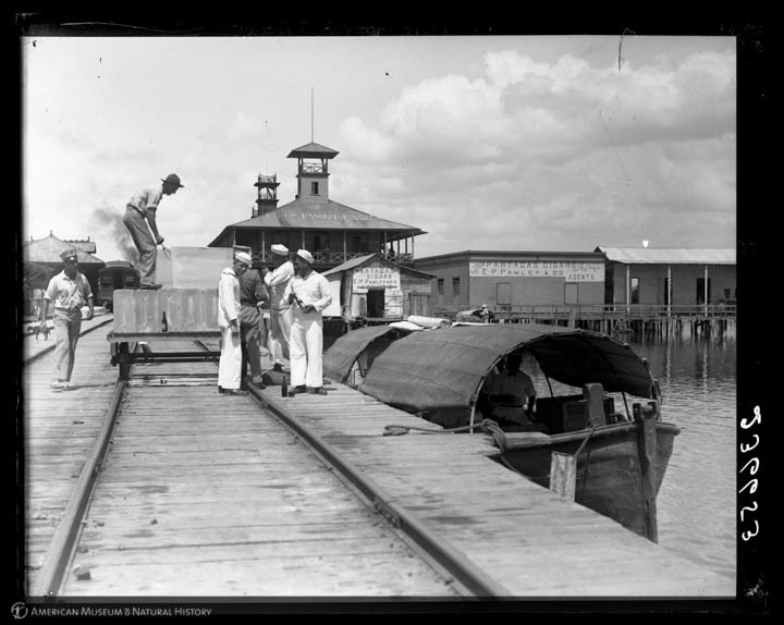 Loading ice for the naval station, sailors on the dock, Guantanamo, Cuba, July, 1917