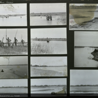 Expedition team in and around river, being helped across water by African men, Africa, expedition photographs mounted to card