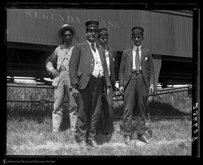 Railway conductors outside secunda clase train car, Cuba, July, 1917