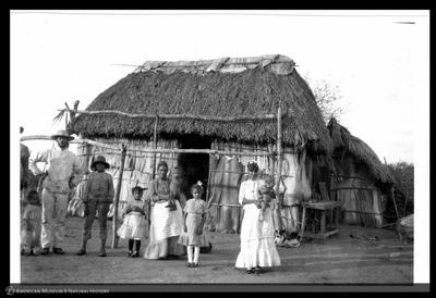 Cuban family outside their home, Trinidad, Cuba, 1892